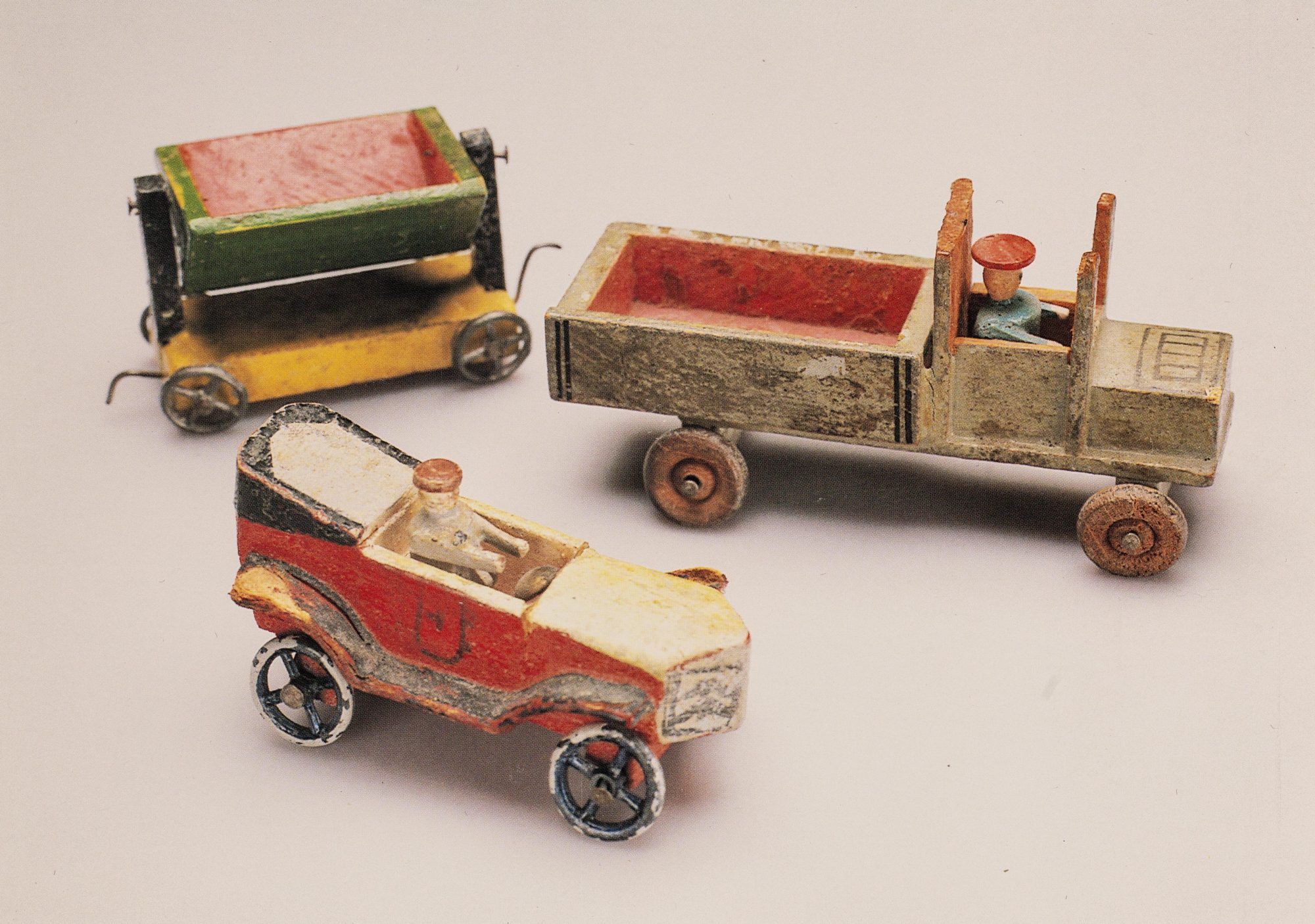 A photo of painted wooden cars from the 1920s, like those used by Klein with her child patients