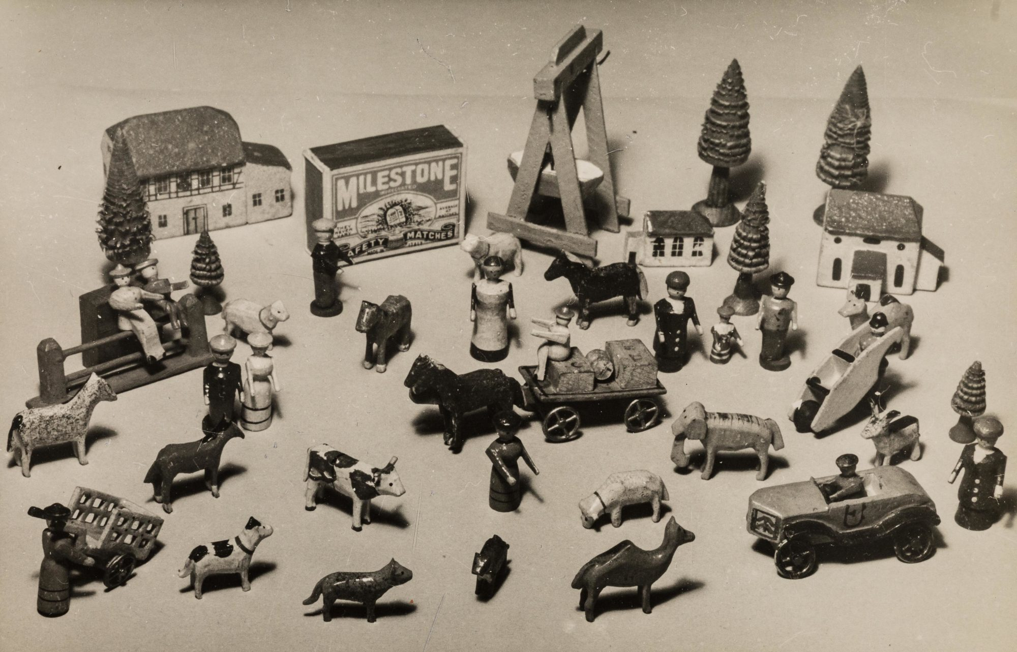 Photograph of wooden toys of the type Klein used with her child patients, including cars, animals and people