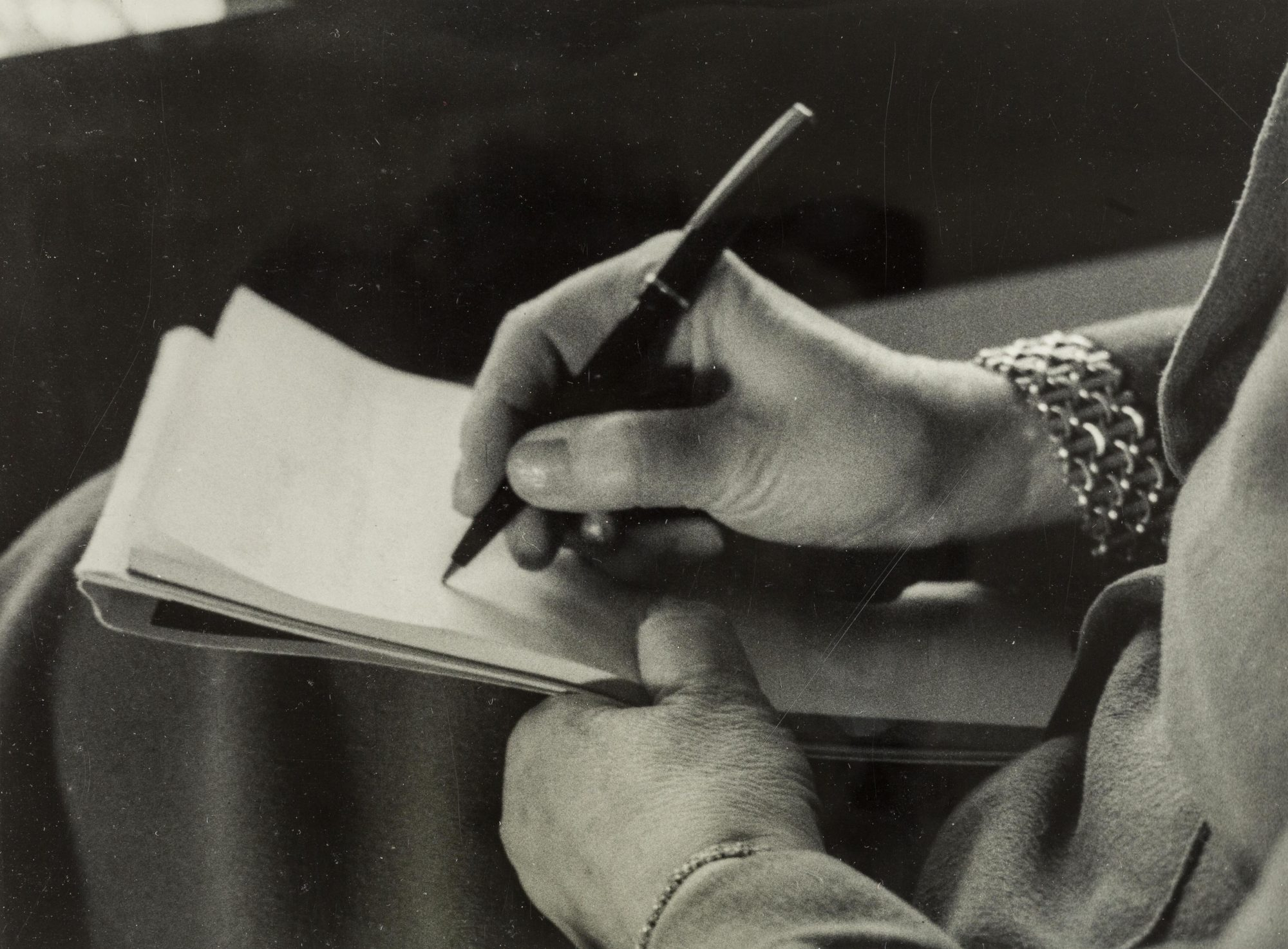 Black and white photo of a close up of Melanie Klein's hand writing on a notepad