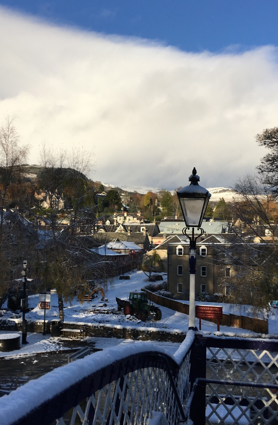 Photo of a snowy scene in Pitlochry in Scotland.