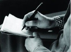 Black and white photo of Melanie Klein writing