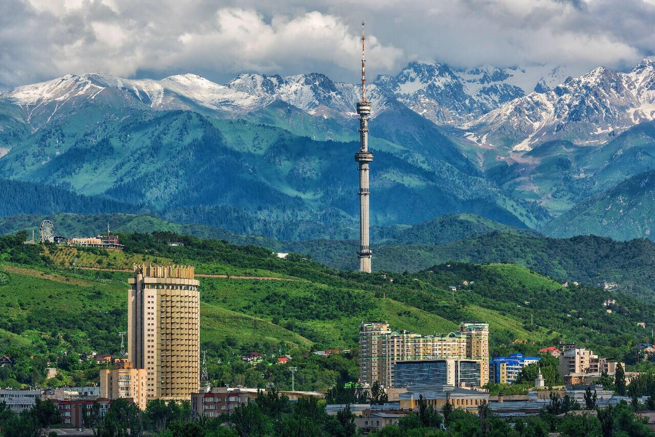 Photo of the view of the city of Almaty, Kazakhstan, against a mountain backdrop
